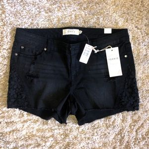 Black distressed denim shorts with lace detail